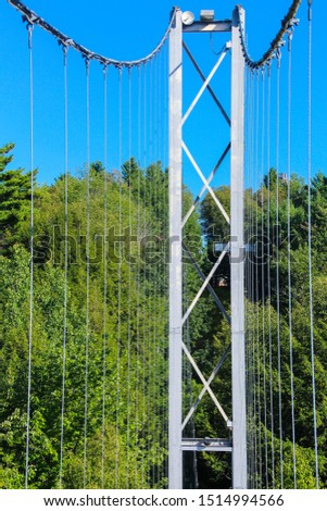 Pier and cable of suspension bridge, Gorge park, Coaticook, Quebec #1514994566
