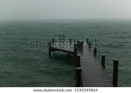 Pier and lake with rain