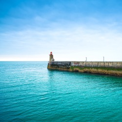 Pier and lighthouse on sunset, panoramic view. Fecamp harbor. Normandy France