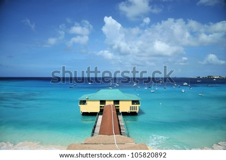 Pier and rooms located on the island of Barbados / Ocean Living