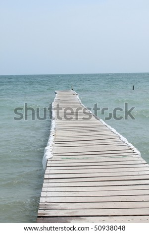 Pier at beach - View from a wooden jetty over