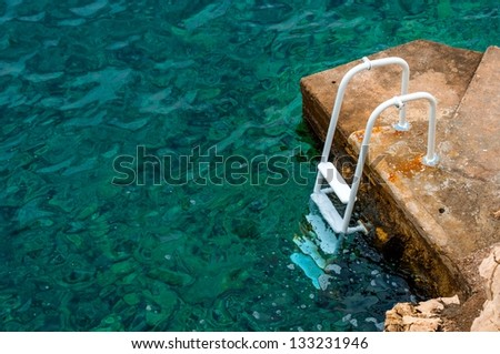 Pier at the ocean with ladder