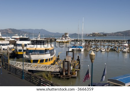 Pier 39 boats and Alcatraz in the background in San Francisco California