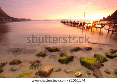 pier in a small bay at dawn