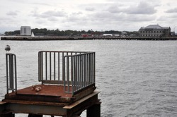Pier in New-York with lost sneakers and gull near heliport in Hudson river
