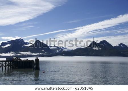 Pier in Valdez Harbor  with mountain landscape