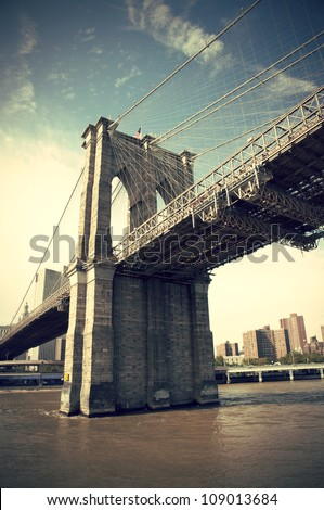 Pier of Brooklyn Bridge in New York CIty, vintage style, Manhattan, New York, USA #109013684