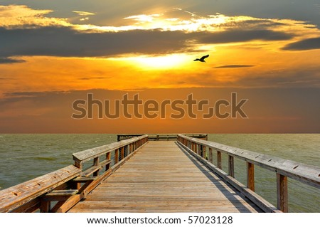 Pier on the Chesapeake Bay leading to a sunset