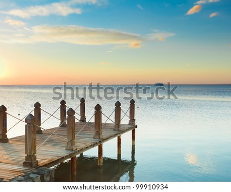 Pier over Sunset Waters