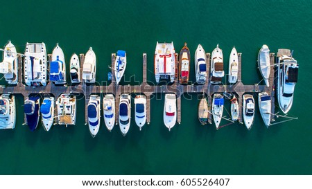 Pier speedboat. A marina lot. This is usually the most popular tourist attractions on the beach.Yacht and sailboat is moored at the quay.Aerial view by drone.Top view. #605526407