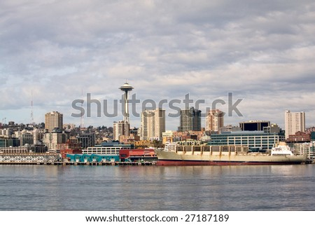 Pier 59 waterfront area of Seattle, including downtown and the Space Needle, taken from the ferry in the Puget Sound.