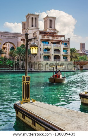 Pier with a lantern in the Strait of Jumeirah in Dubai on the building background