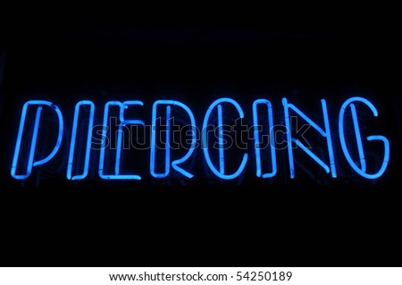 Piercing Electric Blue Neon Text Sign - stock photo