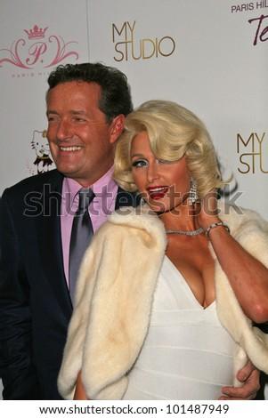 "Piers Morgan and Paris Hilton at Paris Hilton's ""Tease"" Fragrance Launch, MyStudio, Hollywood, CA. 09-10-10"