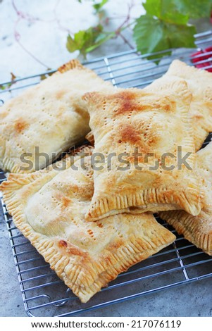 Pies with apples of puff pastry, homemade cakes