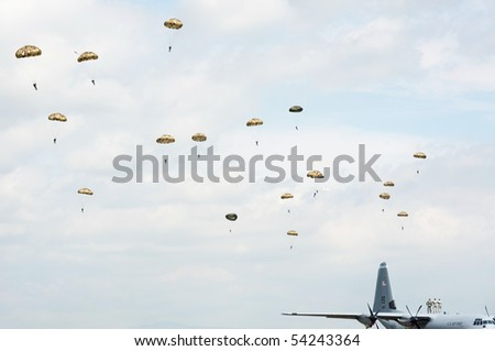 PIESTANY, SLOVAKIA - MAY 29: soldiers standing on C-130J Super Hercules are observing paratroopers in the air during airshow in Piestany, Slovakia, May 29, 2010