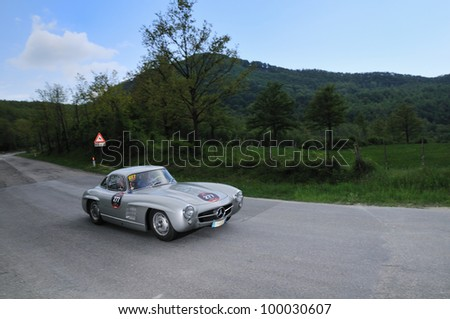 PIEVE SANTO STEFANO (AR), ITALY - MAY 13: Loris Beghetto drives a silver 1955 built Mercedes-Benz 300 SL vintage car during time trial at 1000 Miglia race on May 13, 2011 near Pieve Santo Stefano (AR)