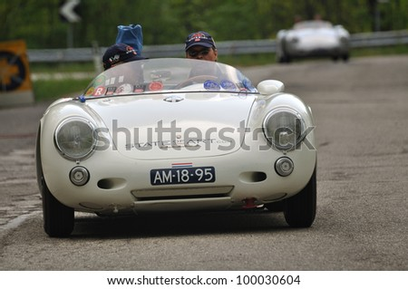 PIEVE SANTO STEFANO (AR), ITALY - MAY 13: Prince Bernhard Van Oranje Nassau drives a 1955 white PORSCHE 550-1500 RS vintage car during a time trial at 1000 Miglia race on May 13, 2011 near P.S.Stefano