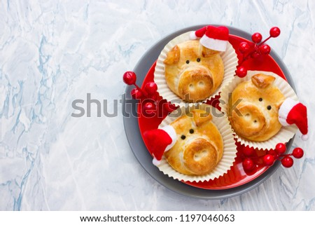 Pig bread buns, funny baking idea shaped cute piggy faces, symbolic food for new year 2019 #1197046063
