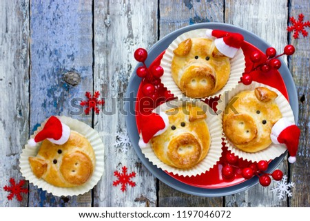 Pig bread buns, funny baking idea shaped cute piggy faces, symbolic food for new year 2019 #1197046072