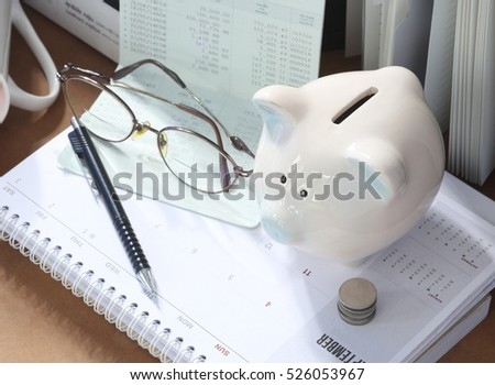 Pig piggy bank, coins, bank book, glasses. The concept of saving money #526053967