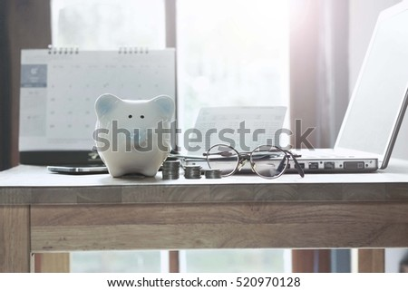 Pig piggy bank, coins, bank book, notebook, desktop concept of saving money.