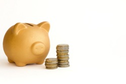 Pig piggy bank gold color with stacks of euro coins of different denominations on a white background with space for text