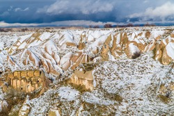 Pigeon houses and fairy chimneys in the famous Pigeon Valley in Cappadocia, Turkey in winter