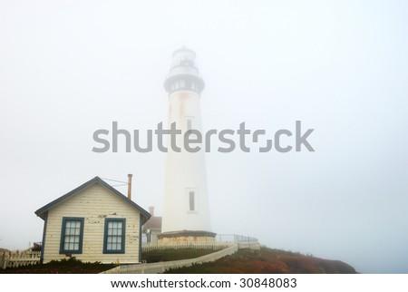 Pigeon Point Lighthouse near Pescadero, California on a foggy day.