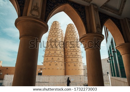 Pigeon towers of the Katara cultural village in Doha,Qatar framed through an arch. Katara is located on the eastern coast between West Bay District and the Pearl-Qatar Stock fotó ©