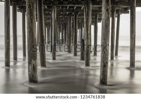 Pigeons under Seacliff fishing pier. Seacliff State Beach, Aptos, Santa Cruz County, California, USA.