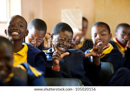 PIGGS PEAK, SWAZILAND-JULY 29: Unidentified orphan schoolboys on July 29, 2008 in Nazarene Mission School, Piggs Peak, Swaziland. Close to 10% of Swazilands population are orphans, due to HIV/AIDS.