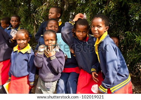 PIGGS PEAK, SWAZILAND-JULY 29: Unidentified Swazi pupils on July 29, 2008 in Nazarene Mission School, Piggs Peak, Swaziland. Close to 10% of Swaziland�s population are orphans, due to HIV/AIDS.