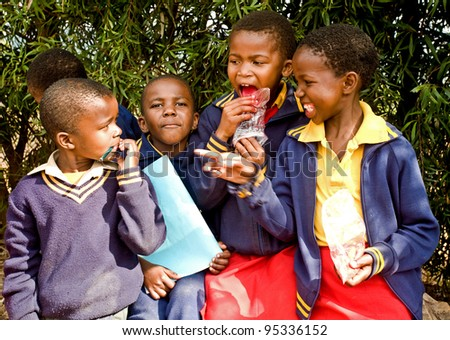 PIGGS PEAK, SWAZILAND-JULY 29: Unidentified Swazi pupils on July 29, 2008 in Nazarene Mission School, Piggs Peak, Swaziland. Close to 10% of Swaziland's population are orphans, due to HIV/AIDS.