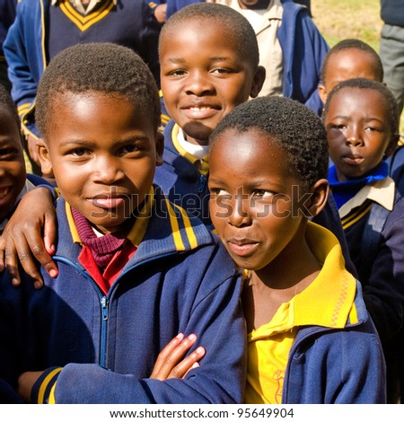 PIGGS PEAK, SWAZILAND-JULY 29: Unidentified Swazi pupils on July 29, 2008 in Nazarene Mission School, Piggs Peak, Swaziland. Close to 10% of Swaziland population are orphans, due to HIV/AIDS.