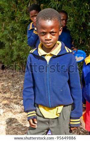 PIGGS PEAK, SWAZILAND-JULY 29: Unidentified Swazi schoolboy on July 29, 2008 in Nazarene Mission School, Piggs Peak, Swaziland. Close to 10% of Swaziland population are orphans, due to HIV/AIDS.