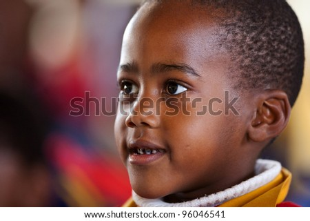 PIGGS PEAK, SWAZILAND-JULY 29: Unidentified Swazi schoolboy on July 29, 2008 in Nazarene Mission School, Piggs Peak, Swaziland. Close to 10% of Swaziland's population are orphans, due to HIV/AIDS.