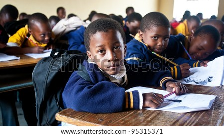PIGGS PEAK, SWAZILAND-JULY 29: Unidentified Swazi schoolboys on July 29, 2008 in Nazarene Mission School, Piggs Peak, Swaziland. Close to 10% of Swaziland's population are orphans, due to HIV/AIDS.