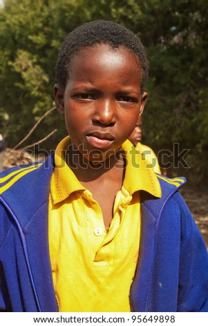 PIGGS PEAK, SWAZILAND-JULY 29: Unidentified Swazi schoolgirl on July 29, 2008 in Nazarene Mission School, Piggs Peak, Swaziland. Close to 10% of Swaziland population are orphans, due to HIV/AIDS.