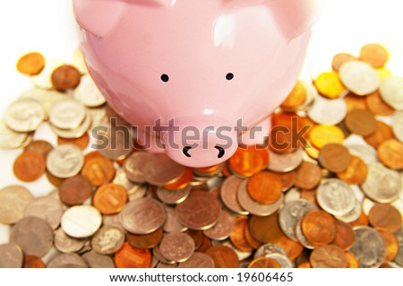 piggy bank and assorted coins, from above