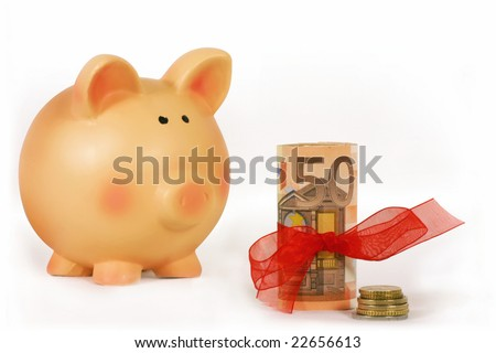 piggy bank and bankroll with a red ribbon isolated in white background