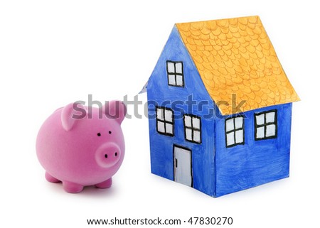 Piggy bank and blue paper house with clipping path