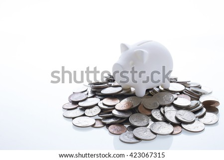 Piggy bank and coins #423067315