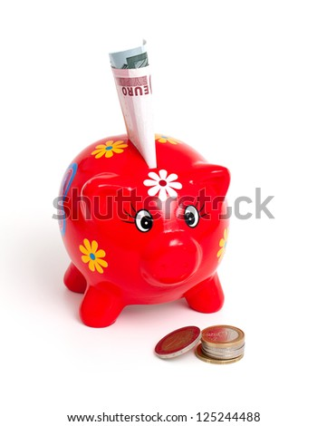 piggy bank and euros isolated on white background