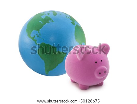 Piggy bank and globe isolated on white