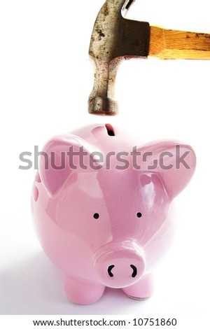 Piggy bank and hammer closeup on white