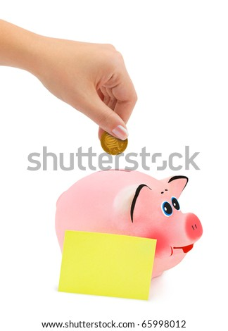 Piggy bank and hand with coin isolated on white background