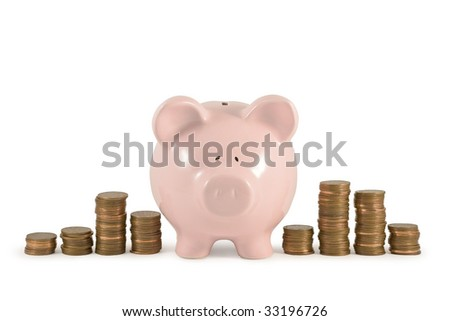 Piggy bank and piles of coins
