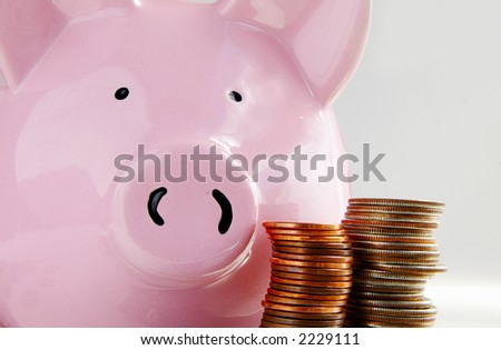 Piggy bank and stacked coins