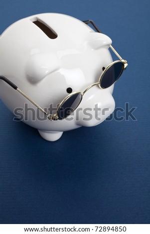 Piggy Bank and Sunglasses , concept of savings